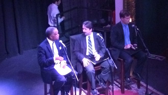Former state Sen. Eric Kearney, left, Cincinnati lawyer John Sheil and lawyer Christopher Wagner debate Issue 3 at the Woodward Theater on Thursday night.
