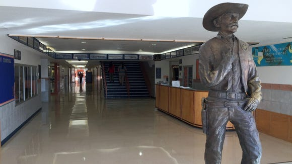 A statue stands at the entrance to Riverside High School.