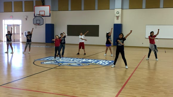 Montana Vista Elementary School students on the cheerleading team rehearse a cheer before practice.