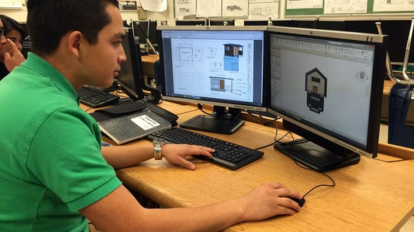 Anthony Cordova designs a home movie theater in the architecture program at the Center for College and Technology Education.