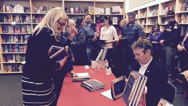 Sen. Rand Paul signs a book for State Rep. Diane St. Onge, R-Lakeside Park, at Joseph-Beth Booksellers in Crestview Hills on Monday.