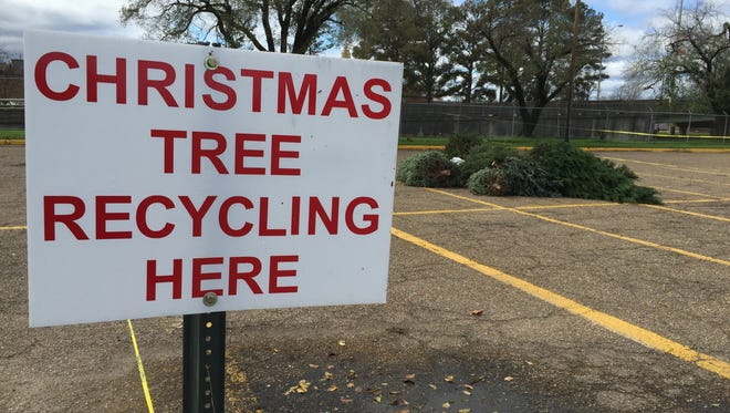 Christmas trees have been dropped off for recycling at the north parking lot of the Monroe Civic Center.