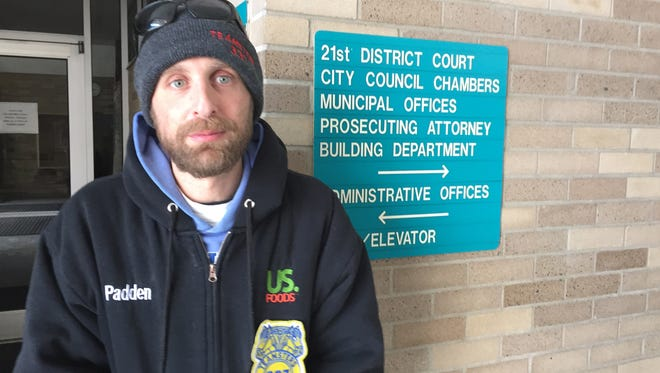 Tim Padden of Lincoln Park is one of several current and former Wayne County homeowners involved in a federal lawsuit accusing various Wayne County communities and the county treasurer's office of wrongdoing in turning their homes over to developers. Padden is standing at the Garden City City Hall on Monday, Jan. 11, 2016.