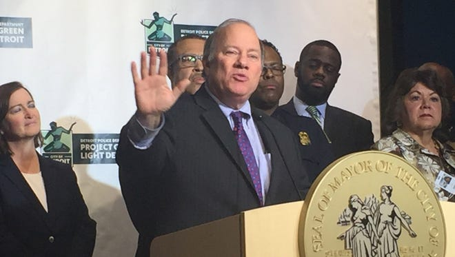 Mayor Mike Duggan (pictured) and Police Chief James Craig announce a pilot program to monitor eight gas stations through a high-definition video system that leaders say will deter crime and make identifying suspects easier. They are at a press conference at  Detroit Public Safety Headquarters on Monday, Jan. 11, 2016.