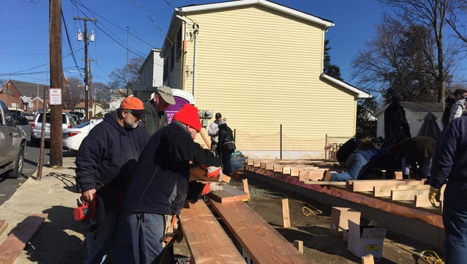 Habitat for Humanity volunteers frame a house in Haverstraw, March 5, 2016