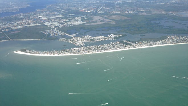 """Fort Myers Beach and San Carlos Island seen from the air.   A controversial proposal for a  """"destination resort"""" at San Carlos would provide affordable housing, some of which would be used by tourism industry workers on the beach."""