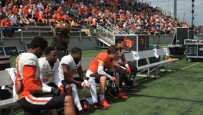 Oregon State players from left, wide receivers Jordan Villamin, Hunter Jarmon and Victor Bolden, quarterback Darell Garretson, and tight Noah Togiai, on the sidelines during Saturday's scrimmage at Hillsboro Stadium.
