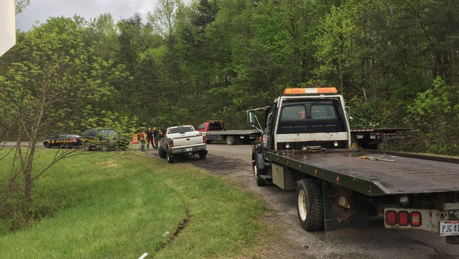 Tow trucks arrive at Union Hill Road to remove vehicles from the property of the slain Rhoden family only hours after their burial Tuesday.