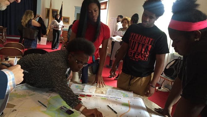 Students from MetEast look at a map of Camden's Parkside neighborhood, part of an effort to get their input on how to improve the area.