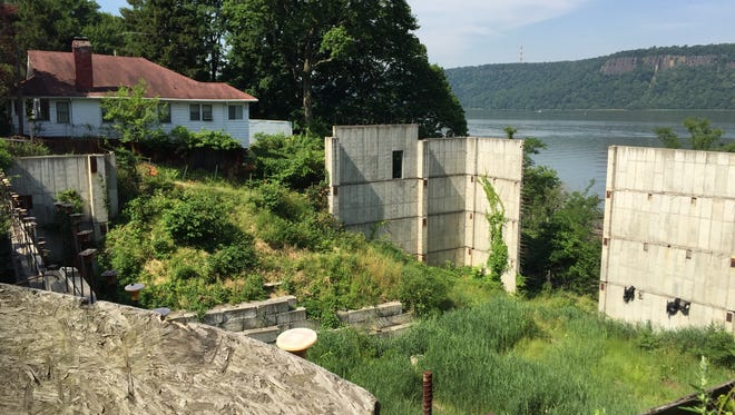The unfinished foundation at 1077 Warburton Ave. in Yonkers has been an open pit for more than 10 years.