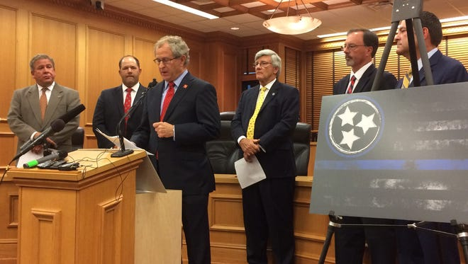 "State Rep. Mark White, R-Memphis, addresses his bill in a ""Blue Lives Matter"" news conference Monday at Legislative Plaza. Other lawmakers in the effort are, from left, House Majority Leader Gerald McCormick, R-Chattanooga; Rep. Andy Holt, R-Dresden; Sen. Todd Gardenhire, R-Chattanooga; Sen. Mike Bell, R-Athens; and Sen. Mark Green, R-Clarksville."