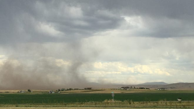 A dry microburst occurs south of Great Falls during a storm that passed through the area last Thursday afternoon.