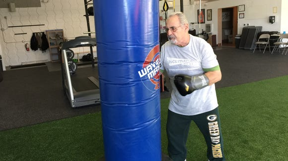 Bob Roth boxes at Fast Forward Fitness in West Allis.