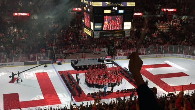 The Red Wings, past and present, and fans raise their sticks at the end of the postgame ceremony for the final game at Joe Louis Arena on Sunday, April 9, 2017.