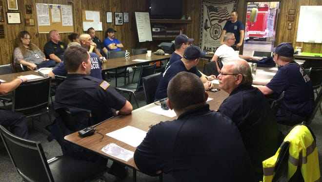Participants in Saturday's mass casualty training in Centerville discuss what they learned during the scenario.