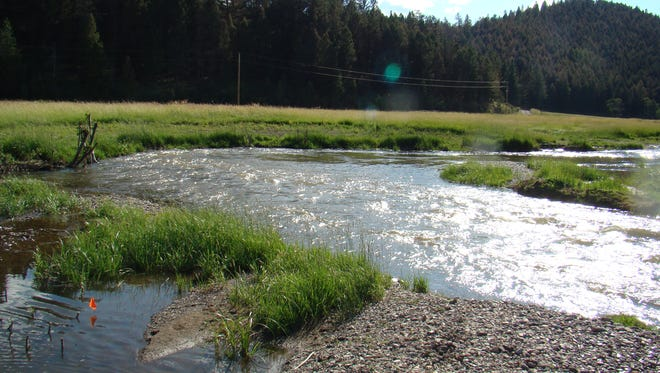 """This section of Nevada Creek on private land, a tributary of the Blackfoot River, was restored in 2010 by Montana Fish, Wildlife and Parks,  the U.S. Fish and Wildlife Service, Wildland Hydrology and several other partners. """"Those fish need those tributaries,"""" says Ron Pierce, an FWP fisheries biologist."""