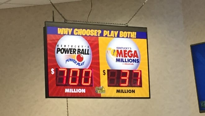 A sign advertises Wednesday's $700 million Powerball jackpot drawing at Ed's in Louisville's PNC Plaza. Aug. 23, 2017