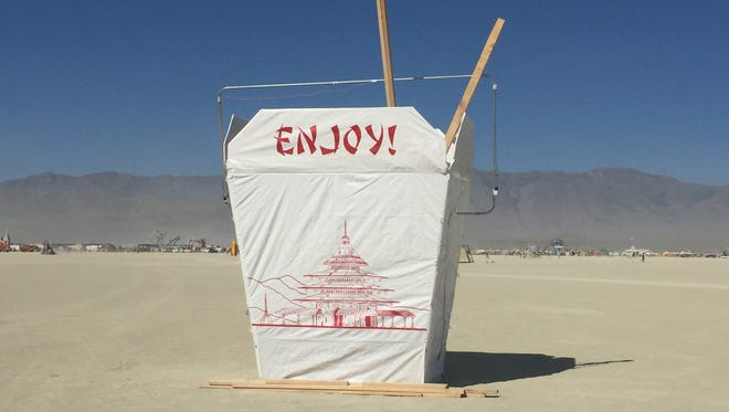 "The ""Giant Takeout Box"" by Jackleg Jackpot of Concord, N.C., makes you crave Chinese food out on the playa. It also gives you fortunes if you reach your hand inside."