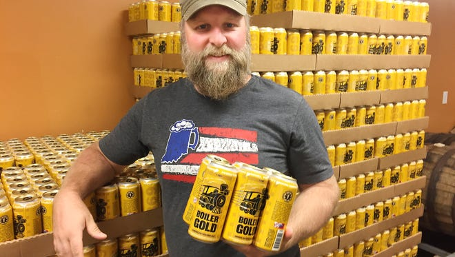 Chris Johnson, owner of People's Brewing Co. in Lafayette, said trying to keep up with initial demand for Boiler Gold, Purdue's first signature beer, has been a good problem to have.