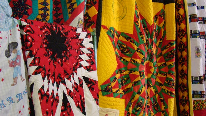 """A burst of color was seen by 2017 Lincoln County fair goers in the indoor area that spot lighted quilt art by Betty Lou Joiner, lifelong county resident. Shown are some of the 50 state """"Star"""" quilts she has created."""