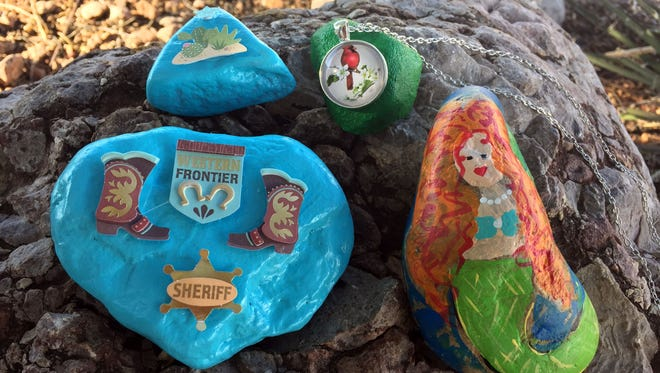 Rocks, painted by members of the Alamo Rocks Facebook group, sit outside the Daily News office and wait to be found and rehidden.