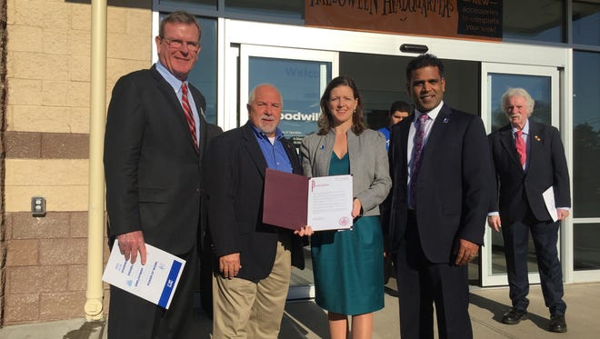 Michael Kerwin of the Somerset County Business Partnership, North Plainfield Mayor Michael Giordano, Goodwill of Greater New York and Northern New Jersey President and CEO Katy Gaul-Stigge and board member Damu Bashyam at the North Plainfield Goodwill ribbon cutting Friday.