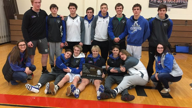 The Foley wrestling team displays its first-place trophy from the 25th Annual Kiffmeyer Duals on Jan. 13 at St. Cloud Tech.  Foley wrestles Perham at 11 a.m. Thursday in the state tournament in St. Paul.
