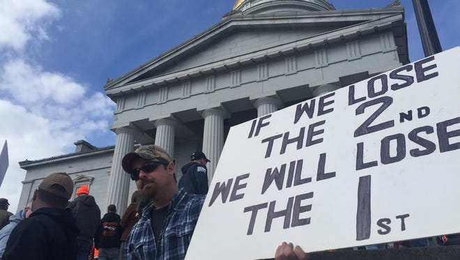 Jason Hill, a Vermont gun rights advocate from Williamstown stands at the Statehouse on Saturday, March 31, 2018.