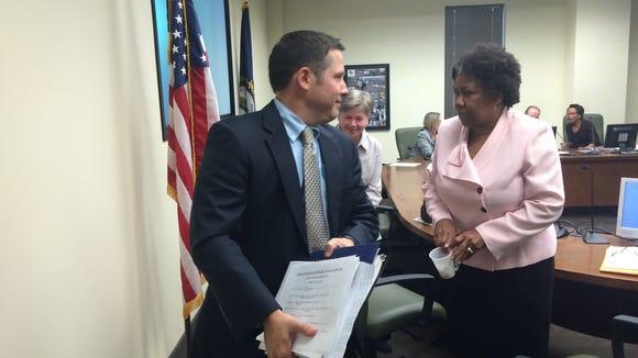 Outgoing MSD board chairman James Craig speaks with board member Joyce Horton Mott,, on Monday