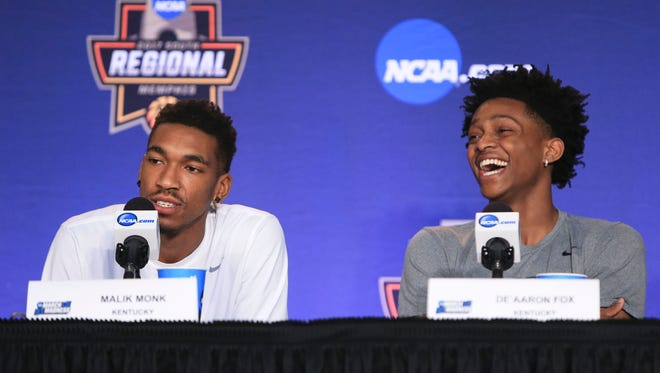 "Kentucky's De'Aaron Fox laughs while Malik Monk answers a question Saturday before the Elite Eight game against North Carolina Sunday in Memphis. John Calipari said ""I'm having fun because of these guys. De'Aaron had it going and they all accepted it."""