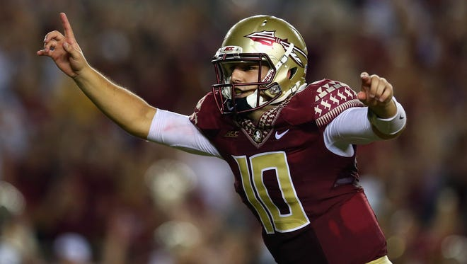 Sean Maguire  celebrates the overtime win against the Clemson Tigers at Doak Campbell Stadium on September 20, 2014 in Tallahassee, Florida.