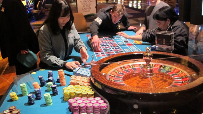 This April 17, 2015 photo shows a dealer counting chips during a game of roulette at the Tropicana Casino and Resort in Atlantic City, N.J. Three New Jersey lawmakers introduced a bill on June 8, 2015 that would ask voters whether to approve new casinos in the northern and central parts of New Jersey.