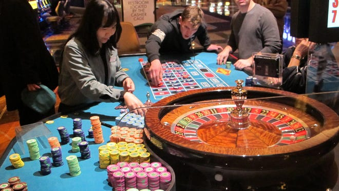 This April 17, 2015 photo shows a game of roulette under way at the Tropicana Casino and Resort in Atlantic City, N.J. On Friday Dec. 11, 2015, New Jersey lawmakers said they will seek a statewide referendum in Nov. 2016 in which voters would be asked whether to approve two new casinos in the northern part of the state. Expanding casino gambling beyond Atlantic City requires amending the state Constitution.