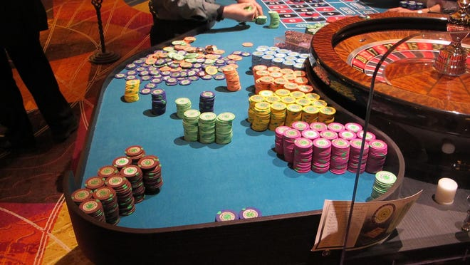 This April 17, 2015 photo shows gambling chips next to a roulette table at the Tropicana casino in Atlantic City, N.J. Leaders of New Jersey's Senate and Assembly remain unable to agree on a single version of a ballot question to put before voters in November asking whether to allow two new casinos in the northern part of the state.