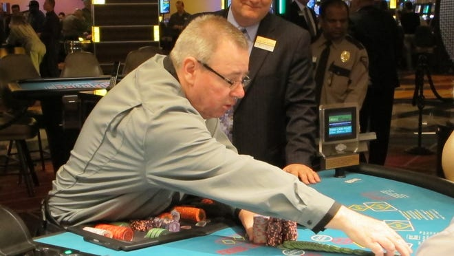 This April 17, 2015 photo shows a dealer conducting a card game game at the Tropicana Casino and Resort in Atlantic City, N.J. On Friday Dec. 11, 2015, New Jersey lawmakers said they will seek a statewide referendum in Nov. 2016 in which voters would be asked whether to approve two new casinos in the northern part of the state. Expanding casino gambling beyond Atlantic City requires amending the state Constitution.