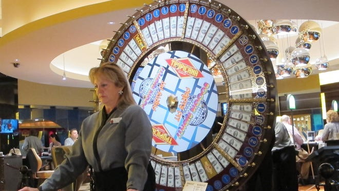 A dealer waits for customers at a cash wheel game at the Tropicana Casino and Resort in Atlantic City. New Jersey voters will consider a referendum in November to approve North Jersey casinos.