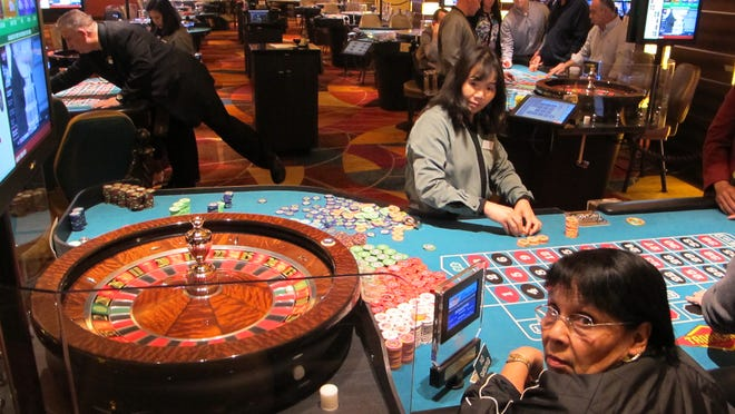 A roulette dealer counts out chips in a newly renovated section of the casino floor at Tropicana Casino and Resort in Atlantic City.