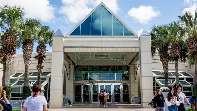 Guests walk outside The Gardens Mall on May 20, 2019 in Palm Beach Gardens.