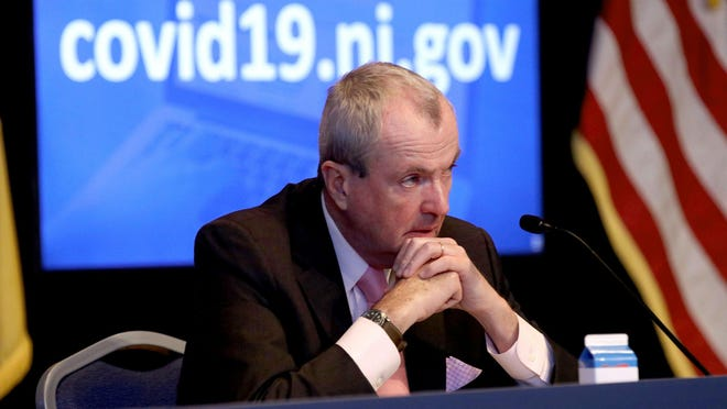 New Jersey Governor Phil Murphy listens during his Friday, June 12, 2020, press conference at War Memorial in Trenton, NJ, on the State's response to the coronavirus.