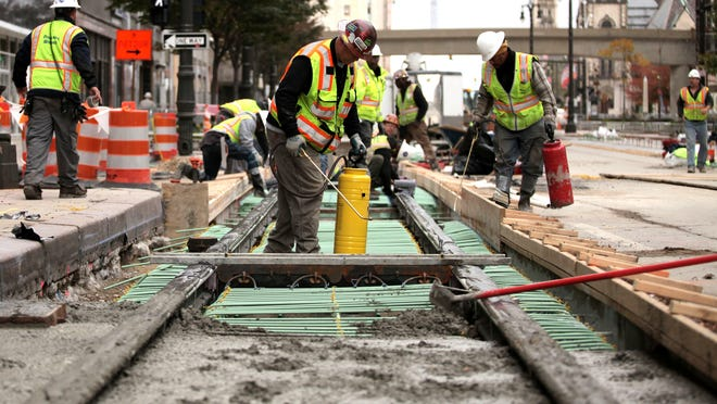 Workers prepare the next section to be poured at the M-1 Rail Project on Oct. 18 on Woodward and John R in Detroit.