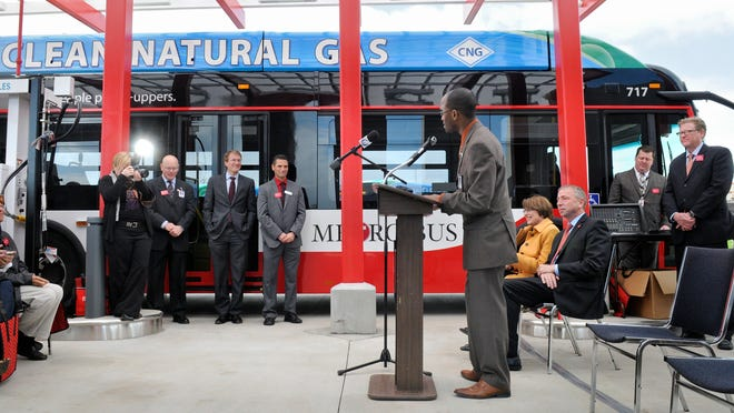Metro Bus Executive Director Ryan Daniel speaks during a ceremony to officially open the new compressed natural gas fueling station Friday.