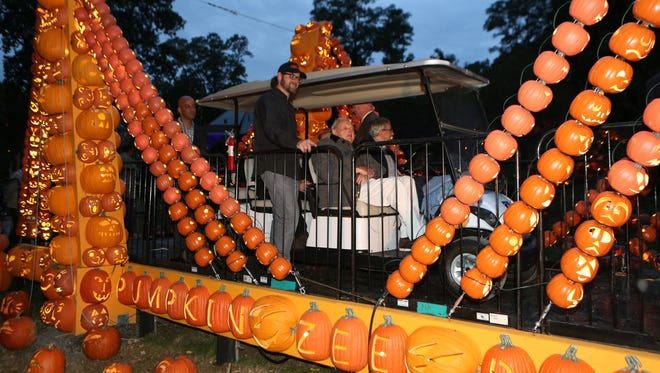 "David Rockefeller, seated in the golf cart, chats with Michael Anthony Natiello, the creative director of The Blaze, standing, on the center span of the ""Pumpkin Zee Bridge"" at The Great Jack O'Lantern Blaze at Van Cortlandt Manor Sept. 29, 2016. The Blaze is featured Sept. 30; Oct. 1,2, 7-10, 13-16, 19-31; and Nov. 3-6, 10-13"