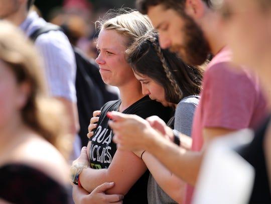 Teddi Shapiro comforts Sarah Elderkin, both UR students,