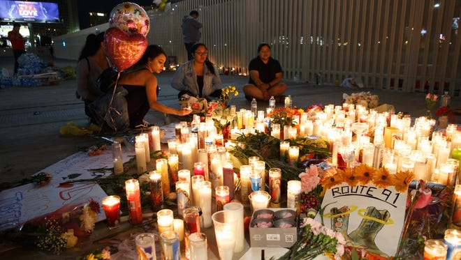 Mourners pay tribute at a makeshift memorial on the Las Vegas Strip for the victims of a mass shooting in Las Vegas on Monday.