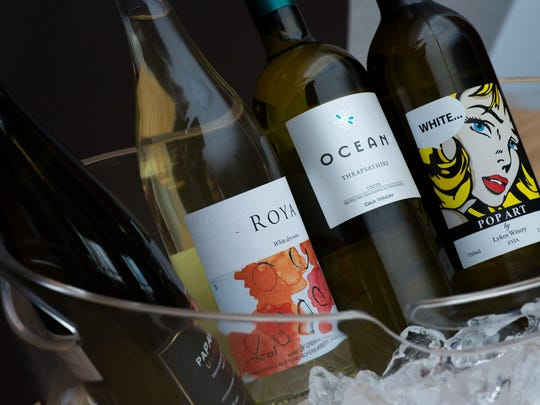 Sierra Nevada Imports sources several affordable white wines from Greece, including Lykos Pop Art, far right, a blend of lemony athiri and aromatic malagouzia.