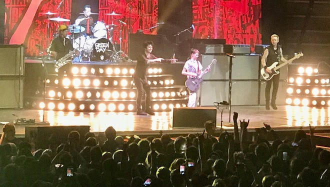 Henry Bresser shows off his guitar chops with Green Day at the Resch Center on March 30. The 13-year-old from Milwaukee is self-taught on the guitar.