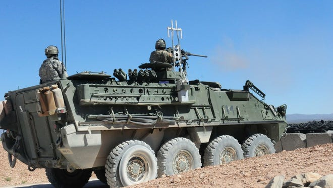 Soldiers from the 3rd Battalion, 41st Infantry Regiment conduct crew qualifications on their Strykers during gunnery.