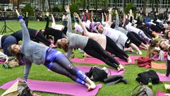 """Yoga participants take part in Manduka's """"project:OM"""""""