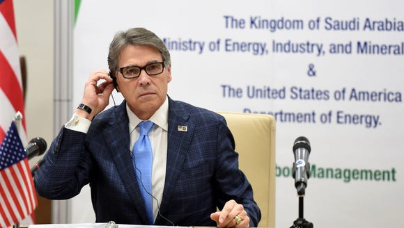 Energy Secretary Rick Perry listens during a signing