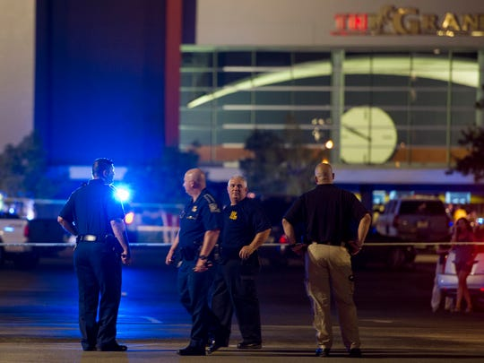 Law enforcement personnel stand near a police line